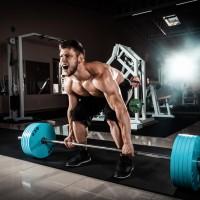 Muscular Man Doing Heavy Deadlift Exercise